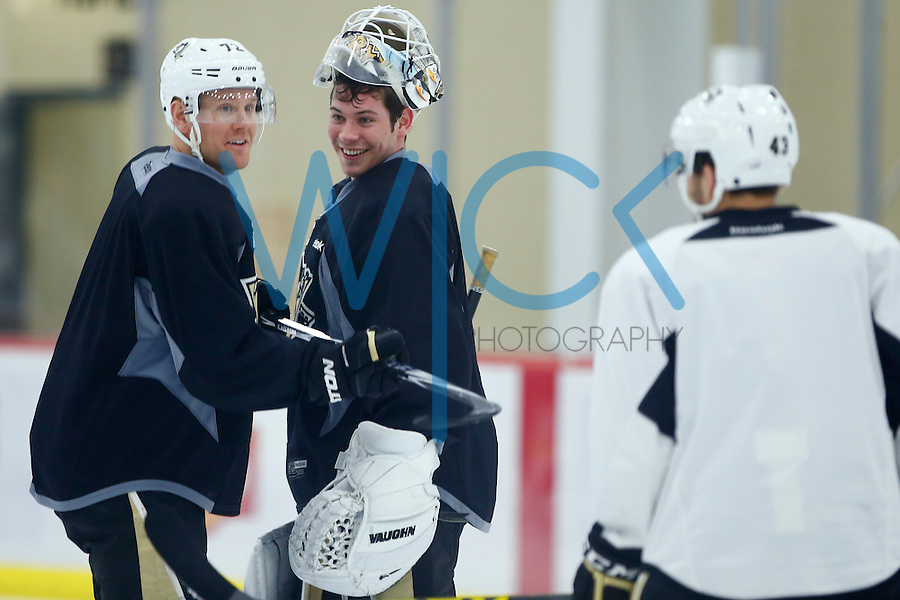 Tristan Jarry of the Pittsburgh Penguins works out during practice at the Lemieux Sports Complex in Cranberry Township, PA on April 11, 2016. (Photo by Jared Wickerham / DKPS)