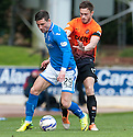 St Johnstone's Michael O'Halloran holds off Dundee Utd's Keith Watson.