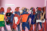"""Education Preschool 3-4 year olds art activity life size figures of chiildren on classroom wall with sign """"United We Stand"""" above them horizontal"""