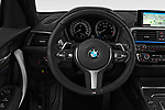 Car pictures of steering wheel view of a 2018 BMW 1 Series Base 5 Door Hatchback