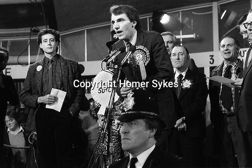 Peter Tatchell (Labour party left of image ) election night he lost to Simon Hughes (Liberal party centre) who is making his acceptance speech. Bermondsey south London 1983.Bermondsey by-election 1980s UK.