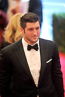 Tim Tebow at the 'Schiaparelli And Prada: Impossible Conversations' Costume Institute Gala at the Metropolitan Museum of Art on May 7, 2012 in New York City. ©mpi03/MediaPunch Inc.