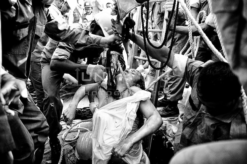 Shaheena is finally out of the building, but not alive. Rescuers on Sunday made a frantic effort to pull out Shaheena from the rubble of the collapsed Rana Plaza. She was alive then. The operation had to be suspended after a fire broke out at the site that day. Her death came as a great shock to everyone at the disaster site. Savar, near Dhaka, Bangladesh