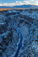 Driving along the flat sage brush land around northern New Mexico and outside of Taos, one is not prepared for nor expecting such a deep canyon carved out by the Rio Grand below.