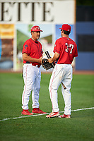 Williamsport Crosscutters manager Pat Borders (10) talks with Adam Haseley (37) before a game against the Mahoning Valley Scrappers on July 8, 2017 at BB&T Ballpark at Historic Bowman Field in Williamsport, Pennsylvania.  Williamsport defeated Mahoning Valley 6-1.  (Mike Janes/Four Seam Images)