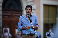 """Riccardo Magi MP.<br /> <br /> Rome, 27/07/2020. Today, hundreds of people, NGO's (ONG) representatives, actors and politicians gathered in Piazza San Silvestro (near the Italian Parliament) to protest (1.) against the dramatic situation in Libya - erupted in a civil war between the GNA (2.) and the forces of General Khalifa Belqasim Haftar - and to protest against the inhumane conditions of migrant people trapped in legal and illegal prisons in Libya. The aim of the demo was to call the Italian Government to stop funding the """"Libyan Coast Guard"""" and to immediately help and free People in Libya throughout """"Humanitarian Corridors"""", and give them the protection they are entitled of by the International Human Rights Conventions. <br /> From the organisers Facebook event page: «[…] we meet to ask the Italian Government and the European States to stop funding the so-called Libyan coast guard, to close and evacuate the detention centres by transferring migrants out of Libya and to promote corridors to help people on the run find protection without endangering their lives. The men, women and children who take the sea from the Libyan coast flee from situations of extreme misery, despotic regimes, tribal persecutions, ethnic conflicts, wars and environmental catastrophes. And in Libya they are subjected to violence, extortion, detention, torture, rape and torture. A few days ago, on July 16, the Chamber of Deputies [Of the Italian Parliament, ndr] for the fourth consecutive year approved the financing of the Italian mission in Libya, which provides financial support for the so-called Libyan coastguard and training and training of its members. […] The mobilization will be accompanied by readings by Ascanio Celestini, Valentina Carnelutti, Fabrizio Gifuni and Sonia Bergamasco […]».<br /> <br /> Footnotes & Links:<br /> 1. https://www.facebook.com/events/2732849460337428/<br /> 2. 07.05.19 Prime Minister of Libya Fayez al-Serraj Met Italian PM Giuseppe Conte at Palazzo Chigi ht"""
