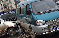 A car smashes into the side of a small van on the outskirts of Chongqing. China has the largest number of traffic fatalities in the world and the problem is worsening as more and more inexperienced drivers get behind the wheel..