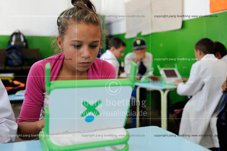 URUGUAY Montevideo, OLPC One Laptop per Child project, the 100 Dollar laptop initiative of Nicholas Negroponte, is implemented in Uruguay for children at all schools under Plan Ceibal, laptops also have access to the internet / URUGUAY Montevideo, fuer alle Kinder an  staatlichen Schulen Uruguays ist das OLPC one laptop per child Programm als Bildungsinitiative Plan Ceibal umgesetzt , jedes Kind bekommt einen 100 Dollar Laptop XO-1 und Zugang zum W-lan Netz der Schule