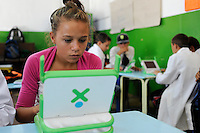 URUGUAY Montevideo, OLPC One Laptop per Child project, the 100 Dollar laptop initiative of Nicholas Negroponte, is implemented in Uruguay for children at all schools under Plan Ceibal, laptops also have access to the internet / URUGUAY Montevideo, fuer alle Kinder an  staatlichen Schulen Uruguays ist das OLPC one laptop per child Programm als Bildungsinitiative Plan Ceibal umgesetzt , jedes Kind bekommt einen 100 Dollar Laptop XO-1 und Zugang zum W-lan Netz der Schule