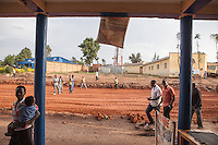 """""""This is the old commercial quarter of Butare. It was made by Arabs in the 1920s so sometimes its called the Arab quarter. The authorities are destroying all the buildings and not paying attention. I walked down these streets everyday for five years.  I saw these shops every day. I bought clothes and food here. I really understood these buildings. Intimately. Now they are being lost and replaced with multi-story buildings."""" Yves Manzi, artist. Butare, Rwanda. Photo by Brendan Bannon. Feb 27, 2014."""
