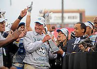 Nov. 27, 2009; Las Vegas, NV, USA; Las Vegas Locomotives head coach Jim Fassel receives the WIlliam Hambrecht Championship Trophy from UFL commissioner Michael Huyghue against the Florida Tuskers during the UFL championship game at Sam Boyd Stadium. The Locomotives defeated the Tuskers 20-17 in overtime. Mandatory Credit: Mark J. Rebilas-