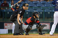 Umpire Sam Burch and Jacksonville Jumbo Shrimp catcher Santiago Chavez (13) during a Southern League game against the Mississippi Braves on May 4, 2019 at Trustmark Park in Pearl, Mississippi.  Mississippi defeated Jacksonville 2-0.  (Mike Janes/Four Seam Images)