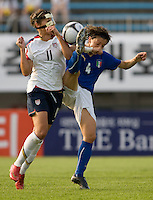 USWNT midfielder (11) Carli Lloyd fights for the ball with Italy's (4) Alessia Tuttino during the last group stage game at the Peace Queen Cup.  The USWNT defeated Italy, 2-0, at the Suwon Sports Center in Suwon, South Korea.