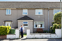 Pictured: Anne Parker at her house in Pontypridd, Wales, UK. Monday 02 July 2018<br /> Re: Pensioner Anne Parker says the peace and quiet of her garden has been shattered after a car wash was installed by rental firm Enterprise on the other side of her back fence in Pontypridd, Wales, UK.