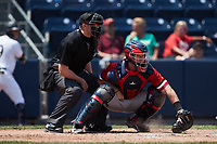 Rochester Red Wings catcher Jakson Reetz (15) reaches for a pitch in the dirt as home plate umpire Jacob Metz looks on during the game against the Scranton/Wilkes-Barre RailRiders at PNC Field on July 25, 2021 in Moosic, Pennsylvania. (Brian Westerholt/Four Seam Images)
