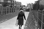 Wandsworth south London 1970s Black British woman returns home from the Arndale shopping Centre.