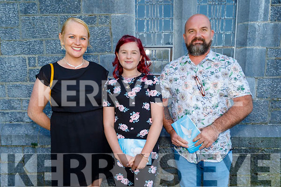 Ria Brosnan receiving her Confirmation in St Gertrude's Firies on Saturday with her parents Sandra and Sean Brosnan.