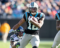 CHARLOTTE, NC - DECEMBER 15: D.J. Moore #12 of the Carolina Panthers evades a tackle by Bradley McDougald #30 of the Seattle Seahawks during a game between Seattle Seahawks and Carolina Panthers at Bank of America Stadium on December 15, 2019 in Charlotte, North Carolina.