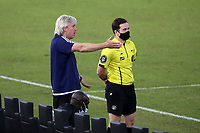 RICHMOND, VA - SEPTEMBER 30: Head coach John Wolyniec of New York Red Bulls II argues with fourth official JC Griggs during a game between North Carolina FC and New York Red Bulls II at City Stadium on September 30, 2020 in Richmond, Virginia.