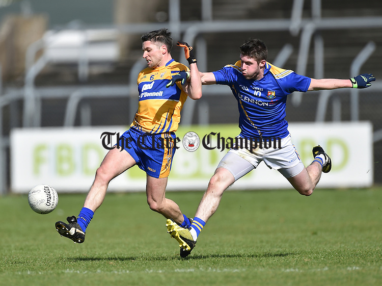 Gordon Kelly  of Clare in action against Robbie Smyth of Longford during their National League Division 3 Round 6 game in Cusack park. Photograph by John Kelly.