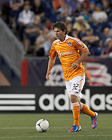 Houston Dynamo defender Bobby Boswell (32) at midfield. In a Major League Soccer (MLS) match, the New England Revolution tied Houston Dynamo, 2-2, at Gillette Stadium on May 19, 2012.
