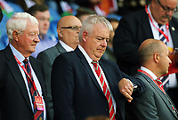 First Minister for Wales Carwyn Jones (C) check the time during the FIFA World Cup Qualifier Group D match between Wales and Austria at The Cardiff City Stadium, Cardiff, Wales, UK. Saturday 02 September 2017