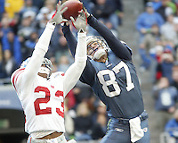 Seattle Seahawks wide receiver Joe Jurevicius pulls in a Matt Hasselbeck pass just out of the reach of New York Giants cornerback #23 Corey Webster during the first quarter at Quest Field in Seattle, WA.