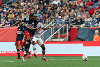 FOXBOROUGH, MA - JULY 25: Maciel #13 of New England Revolution and Mason Toye #13 of CF Montreal battle for the ball during a game between CF Montreal and New England Revolution at Gillette Stadium on July 25, 2021 in Foxborough, Massachusetts.