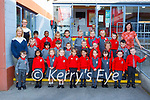 Marie Coleman and Breda Flanagan Teacher and  Aoife Doona SNA with their Junior Infants class in Holy Cross Mercy Killarney on Monday (School has a no name policy)