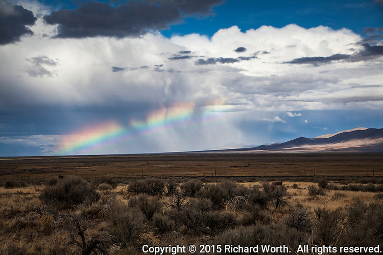 Clouds above.  Sage brush below.  It's a Rainbow Sandwich!  Captured along Interstate Highway 80 in northern Nevada.