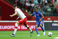 8th September 2021; PGE National Stadium, Warsaw, Poland: FIFA World Cup 2022 Football qualification, Poland versus England;  JAN BEDNAREK beaten by the inside pass by RAHEEM STERLING