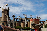 Near Spoleto: A cement factory in the countryside, under a beautiful sky that enhances the metallic structures.