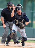GCL Braves catcher Troy Snitker #2 fields a bunt in front of umpire Jorge Teran during a game against the GCL Pirates at Disney Wide World of Sports on June 25, 2011 in Kissimmee, Florida.  The Pirates defeated the Braves 5-4 in ten innings.  (Mike Janes/Four Seam Images)