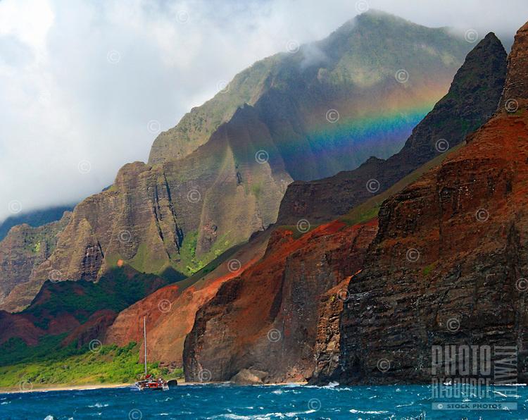 Rainbow over Na Pali coast, Kauai, Hawaii.