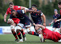 Tjiuee Uanivi of London Scottish is tackled during the Greene King IPA Championship match between London Scottish Football Club and Jersey at Richmond Athletic Ground, Richmond, United Kingdom on 16 December 2017. Photo by Mark Kerton / PRiME Media Images.