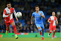 21st September 2021; Etihad Stadium,Manchester, England; EFL Cup Football Manchester City versus Wycombe Wanderers; Ferran Torres of Manchester City and Ryan Tafazolli of Wycombe Wanderers race after the ball