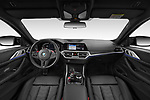 Stock photo of straight dashboard view of 2021 BMW M4-Coupe Competition 2 Door Coupe Dashboard