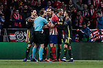 Atletico de Madrid's Diego Godin and Juventus' players have words with the referee during UEFA Champions League match, Round of 16, 1st leg between Atletico de Madrid and Juventus at Wanda Metropolitano Stadium in Madrid, Spain. February 20, 2019. (ALTERPHOTOS/A. Perez Meca)