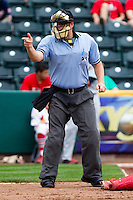 Home Plate Umpire Brandon Misun calls a strike during a game between the Arkansas Travelers and the Springfield Cardinals on May 10, 2011 at Hammons Field in Springfield, Missouri.  Photo By David Welker/Four Seam Images..