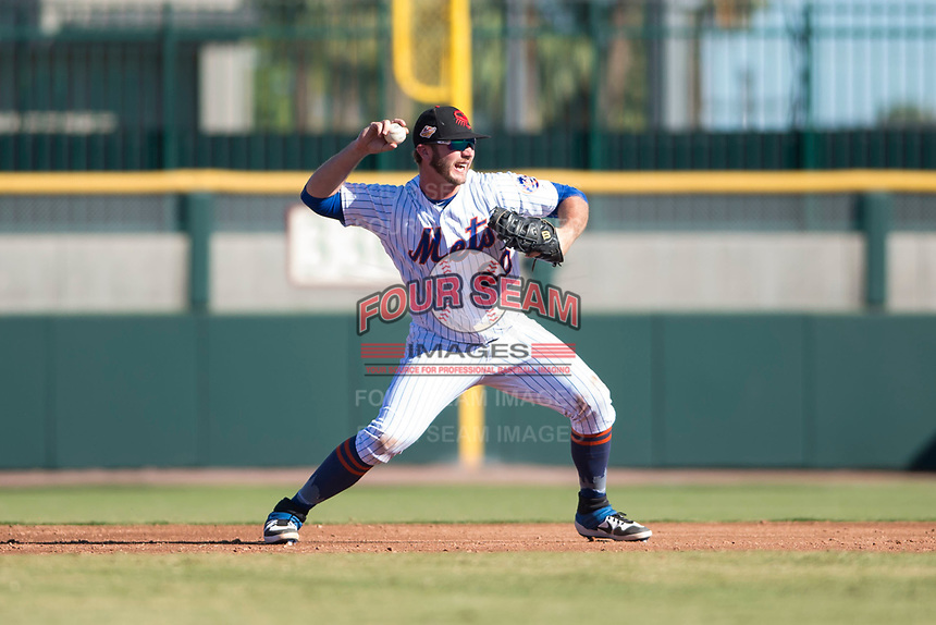 Scottsdale Scorpions first baseman Peter Alonso (20), of the New York Mets organization, throws to first base during an Arizona Fall League game against the Surprise Saguaros at Scottsdale Stadium on October 26, 2018 in Scottsdale, Arizona. Surprise defeated Scottsdale 3-1. (Zachary Lucy/Four Seam Images)