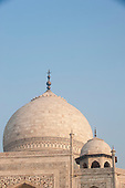 Agra, Uttar Pradesh, India. The Taj Mahal; main dome and secondary cupola with detail of semi-precious stone inlay over the main arch.