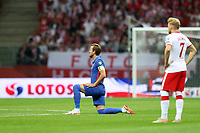 8th September 2021; PGE National Stadium, Warsaw, Poland: FIFA World Cup 2022 Football qualification, Poland versus England;  HARRY KANE  takes a knee against racism as KAMIL JOZWIAK watches on