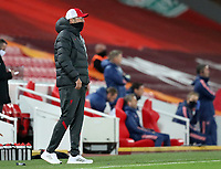1st October 2020; Anfield, Liverpool, Merseyside, England; English Football League Cup, Carabao Cup, Liverpool versus Arsenal; Liverpool manager Jurgen Klopp wears a snood over his face as he looks on from the touchline