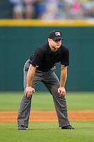 Third base umpire Joseph Born during the International League game between the Pawtucket Red Sox and the Charlotte Knights at BB&T Ballpark on August 9, 2014 in Charlotte, North Carolina.  The Red Sox defeated the Knights  5-2.  (Brian Westerholt/Four Seam Images)
