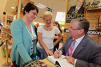 NO FEE PICTURES.15/10/11 Eason, Ireland's leading retailer of books, stationery, magazines and lots more, hosted a book signing by RTE presenter, Joe Duffy. Pictured at Eason,O'Connell Street, Dublin is Joe Duffy who signed copies of his new autobiography Just Joe..Follow Eason on Twitter @easons. Pictured with Joe Duffy is Bernadette, Lucan and Antoinette Chapelizod. Pictures:Arthur Carron/Collins
