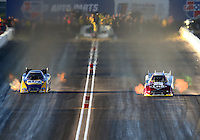Feb 21, 2014; Chandler, AZ, USA; NHRA funny car driver Tim Wilkerson (right) races alongside Ron Capps during qualifying for the Carquest Auto Parts Nationals at Wild Horse Pass Motorsports Park. Mandatory Credit: Mark J. Rebilas-USA TODAY Sports