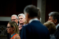 United States Senator Bill Cassidy (Republican of Louisiana), third from left, listens while United States Senator Kyrsten Sinema (Democrat of Arizona), left, makes remarks after the vote on the motion to invoke cloture to proceed to the consideration of H.R. 3684, the INVEST in America Act on Capitol Hill in Washington, DC on Wednesday, July 28, 2021. The vote to begin discussion of the bipartisan infrastructure bill agreed to by the White House, was 67 to 32. If passed, the bill would invest close to $1 trillion in roads, bridges, ports and other infrastructure without a major tax increase.<br /> Credit: Rod Lamkey / CNP / MediaPunch