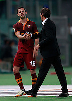 Calcio, Serie A: Roma vs Milan. Roma, stadio Olimpico, 25 aprile 2014.<br /> AS Roma coach Rudi Garcia, of France, greets midfielder Miralem Pjanic, of Bosnia, left, at the end of the Italian Serie A football match between AS Roma and AC Milan at Rome's Olympic stadium, 25 April 2014. AS Roma won 2-0.<br /> UPDATE IMAGES PRESS/Isabella Bonotto