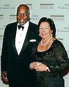 Washington, D.C. - December 2, 2006 -- Ann and Vernon Jordan arrive for the State Department Dinner for the 29th Kennedy Center Honors dinner at the Department of State in Washington, D.C. on Saturday evening, December 2, 2006.  Andrew Lloyd Webber, Zubin Mehta, Dolly Parton, Smokey Robinson and Stephen Spielberg are being honored in 2006 for their contribution to American culture..Credit: Ron Sachs / CNP