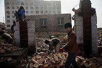 Buildings near the Grand Bazaar are demolished as part of a plan to redevelop the Old City of Kashgar, Xinjiang, China.